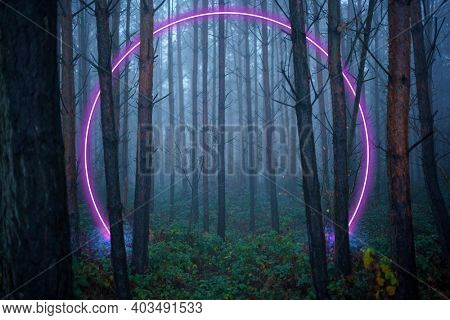 Portal in the form of a neon glow in a foggy forest