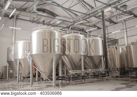 Rows Of Metal Beer Tanks At Microbrewery, Copy Space