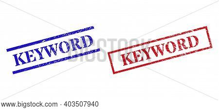 Grunge Keyword Rubber Stamps In Red And Blue Colors. Stamps Have Rubber Texture. Vector Rubber Imita