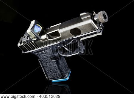 9mm Semi-auto Pistol With A Tritium Sight.