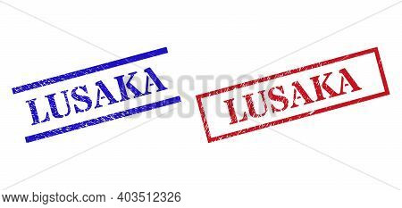 Grunge Lusaka Rubber Stamps In Red And Blue Colors. Stamps Have Draft Texture. Vector Rubber Imitati