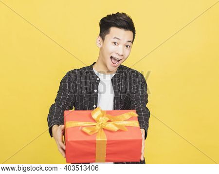 Happy Young Man Holding Gift Box Background