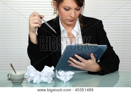 Businesswoman struggling to write presentation
