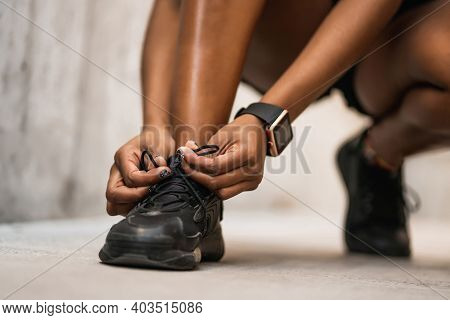Closeup Of Athlete Woman Tying Her Shoelaces