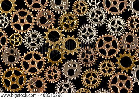 Gears Abstract Background. Products Made Of Different Metals. Macro Photo. Close-up.