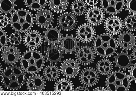 Gears Abstract Background. Products Made Of Different Metals. Macro Photo. Black And White Image. Cl