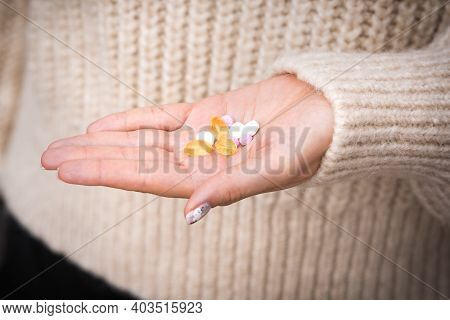 Close Up Of Woman Hand With Vitamins, Minerals And Supplements. B12, D3, K2, Selenium,
