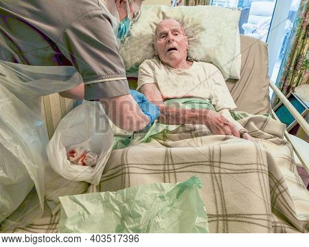 Using Covid-19 Protection,a District Nurse Dresses The 95 Year Old Man's Torn Skin Injury That Occur