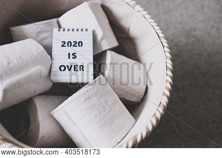 Basket Of Toilet Paper With Memo Saying 2020 Is Over, Facing The Challenges Caused By The Outbreak O