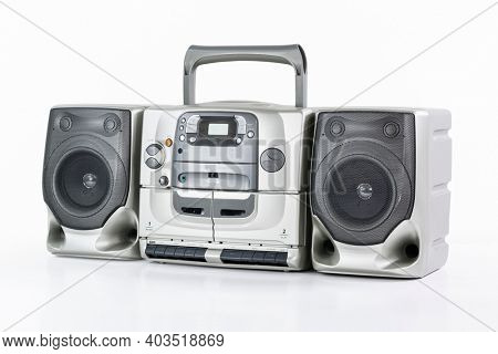 Vintage boom box style portable stereo radio, cd, cassette tape recorder on white.
