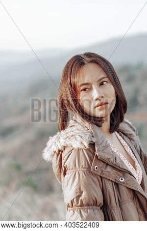 Portrait Of Asian Happy Woman Smilling With Flower Garden , Selective Focus