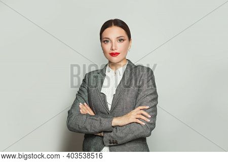Successful Businesswoman With Crossed Arms Smiling On White Background