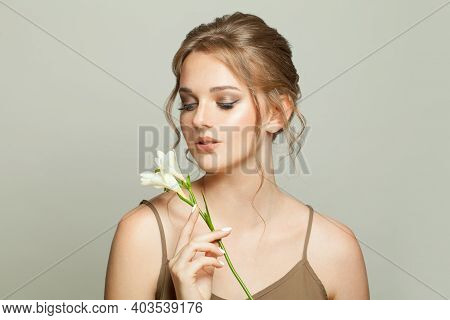 Nice Model Woman With White Flowers, Skincare And Facial Treatment Concept