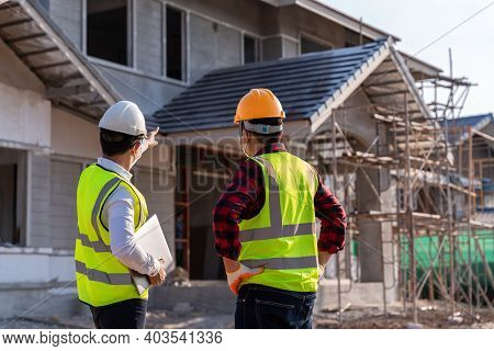 Engineer Recommend House Construction To Supervisor Supervisors At Construction Site. House Builder