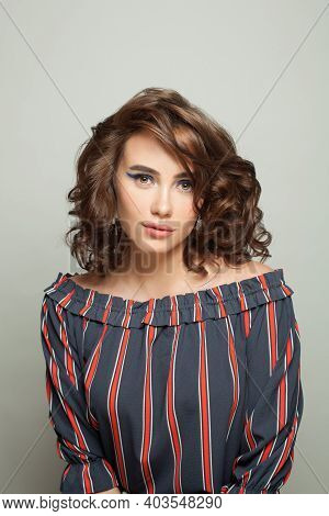 Young Fashion Model Woman With Brown Curly Hairdo On White Background