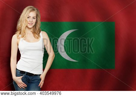 Travel In New Maldives. Happy Cute Blonde Girl Student With New Maldives Flag