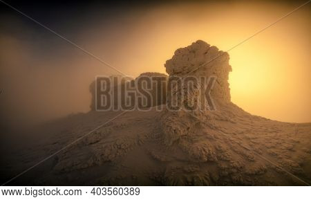 Fantastic orange sunrise over the old Polish observatory on Mount Pip Ivan. Incredible winter landscape with frozen building in top of mountain. Carpathian mountains, Ukraine, Europe