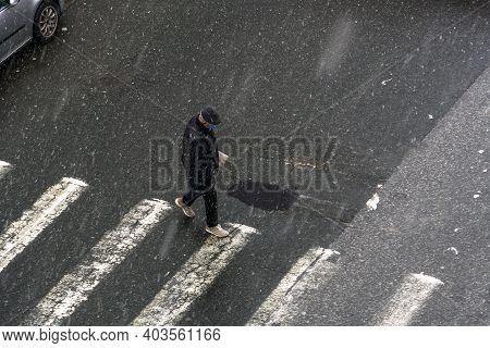 Thessaloniki, Greece - January 16 2019: Old Man Wearing Face Mask On Heavy Snowfall At The City Cent