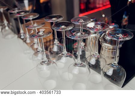 Glasses Of Wine. Glasses Hanging Above The Bar In The Restaurant. Empty Glasses For Wine. Wine And M
