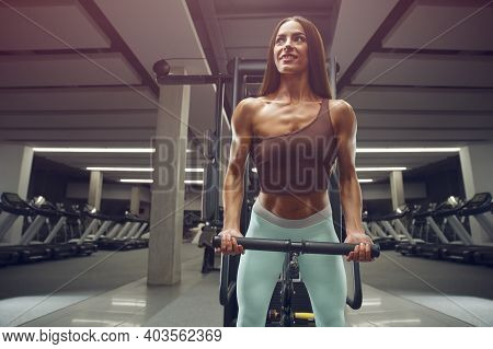 Fitness Woman Pumping Up Biceps Muscles Workout Fitness And Bodybuilding Concept Gym Background Exer