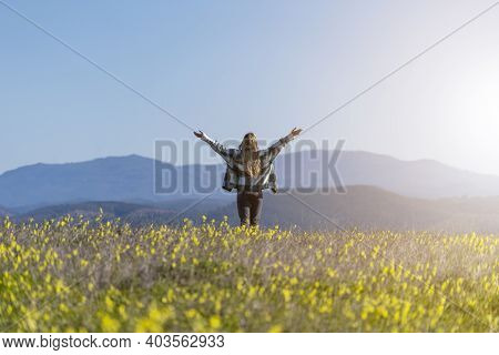 Beautiful Girl Walking On A Field With Flowers Showing Happiness And Joy Seeking Freedom. People Con