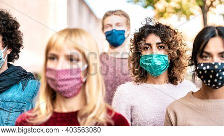 Urban Crowd Of Citizens Walking On City Street Covered By Face Mask - New Normal Society Concept Wit
