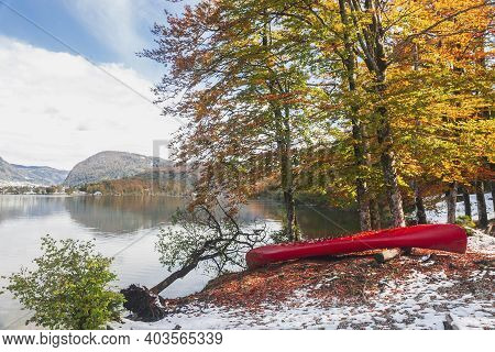 Canoe In The Autumn Forest On The Shore Of Lake Bohinj In Slovenia