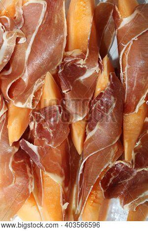 Melon Slices With Iberian Ham Close Up