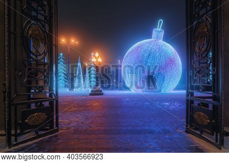 Big Illuminated Christmas Ball Decoration Near Main Entrance Of Gorky Park At Night In Moscow. Russi