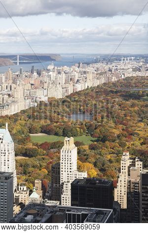 Central Park On Manhattan Island, Surrounded By New York Skyscrapers. Hudson River Is Visible In The