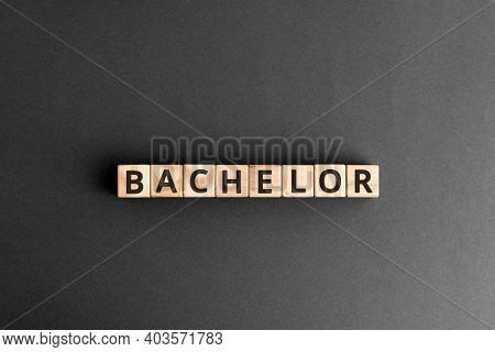 Bachelor - Word From Wooden Blocks With Letters, Bachelor Men Or  Education Concept,  Top View On Gr