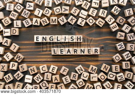 English Learner - Phrase From Wooden Blocks With Letters, Student  English Learner Concept, Random L