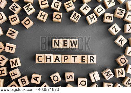 New Chapter - Words From Wooden Blocks With Letters, Starting New Life New Chapter Concept, Random L