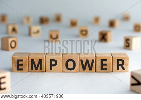 Empower - Word From Wooden Blocks With Letters, Empower Concept, Random Letters Around, White  Backg