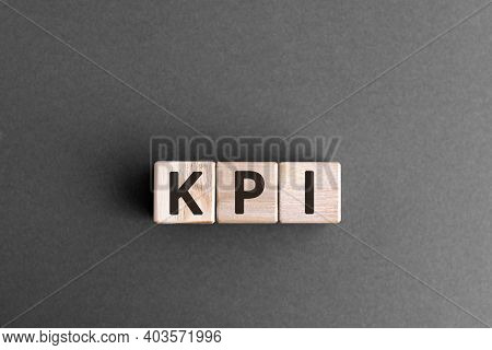 Kpi - Wooden Blocks With Letters, Key Performance Indicator Kpi Concept,  Top View On Grey Backgroun