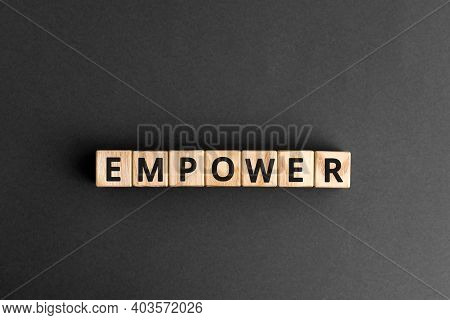 Empower - Word From Wooden Blocks With Letters, Empower Concept, Gray Background