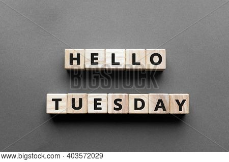 Hello Tuesday - Words From Wooden Blocks With Letters, Hello Tuesday Concept, Top View Gray Backgrou