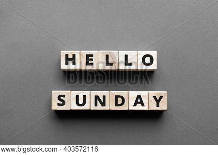 Hello Sunday - Words From Wooden Blocks With Letters, Hello Sunday Concept, Top View Gray Background