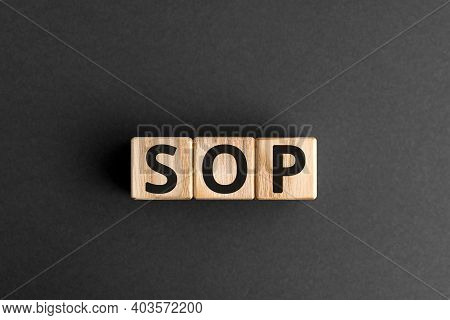 Sop - Acronym From Wooden Blocks With Letters, Abbreviation Sop Standard Operating Procedure Concept