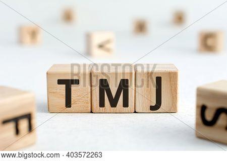 Tmj - Acronym From Wooden Blocks With Letters, Abbreviation Tmj Temporomandibular Joint Syndrome, Tm