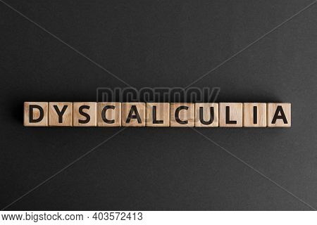 Dyscalculia - Word From Wooden Blocks With Letters, Learning Disability In Math Dyscalculia Concept,