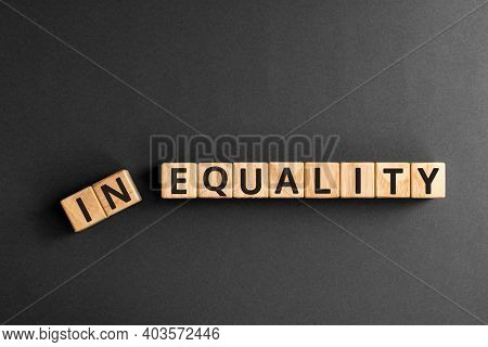 Inequality To Equality - Word From Wooden Blocks With Letters, Economic Social Inequality Concept,