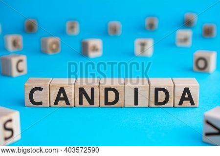 Candida - Word From Wooden Blocks With Letters, A Parasitic Fungus Candida Concept, Random Letters A