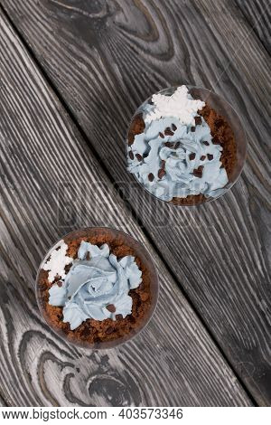 Biscuit Trifles With Chocolate And Cream Cheese. Decorated With Mastic Snowflakes. On Pine Boards.