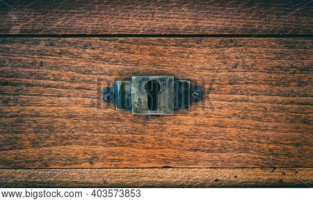 Secret, Mystery Concept. Close Up View Of Keyhole On Wooden Background