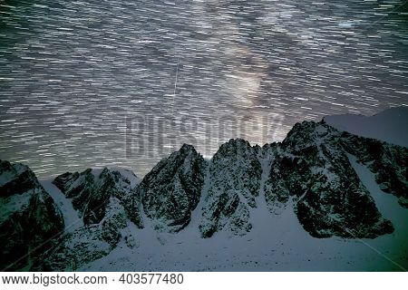 Milky Way and snowy mountains in Altai at night