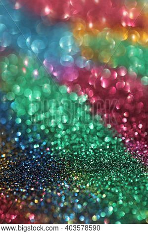 Wallpaper Phone Glitter.glitter Radiance Surface. Multicolored Variegated Glitter With Shining Bokeh