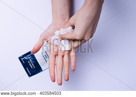 Hands Thoroughly Wiping Palms With Antibacterial Wipes On Alcohol. White Background.