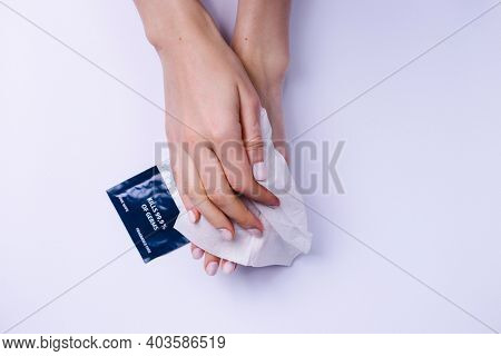Womens Hands Are Carefully Wiping With Antibacterial Wipes That Contain Alcohol. White Background.