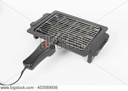 Electric Griddle To Cook Food; On A White Background.